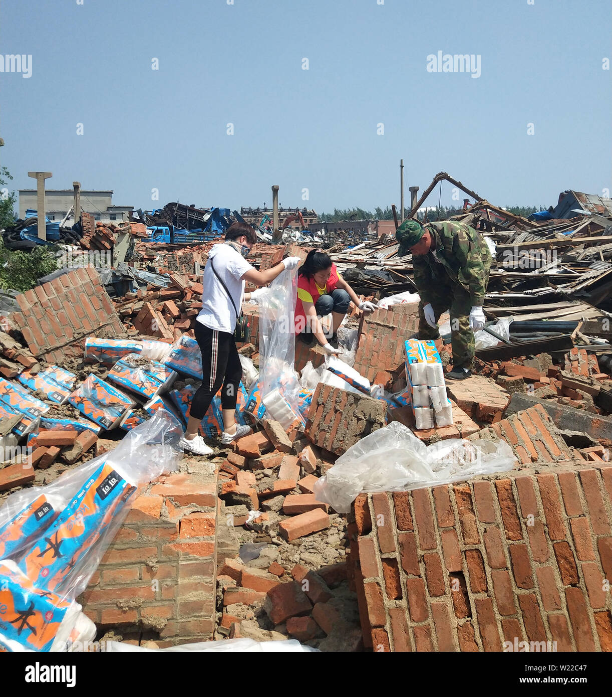 July 5, 2019 - Liaoning, Liaoning, China - Liaoning, China - July 4 2019: A tornado hit more than half of the city of kaiyuan, liaoning province, on July 3, 2019.Six people were killed and more than 190 injured.On July 4, more than 20 volunteers helped pick up toilet paper at a private toilet paper factory to minimize losses. (Credit Image: © SIPA Asia via ZUMA Wire) - Stock Image