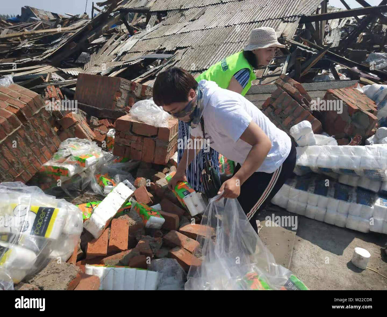 Liaoning, Liaoning, China. 5th July, 2019. Liaoning, China - July 4 2019: A tornado hit more than half of the city of kaiyuan, liaoning province, on July 3, 2019.Six people were killed and more than 190 injured.On July 4, more than 20 volunteers helped pick up toilet paper at a private toilet paper factory to minimize losses. Credit: SIPA Asia/ZUMA Wire/Alamy Live News - Stock Image