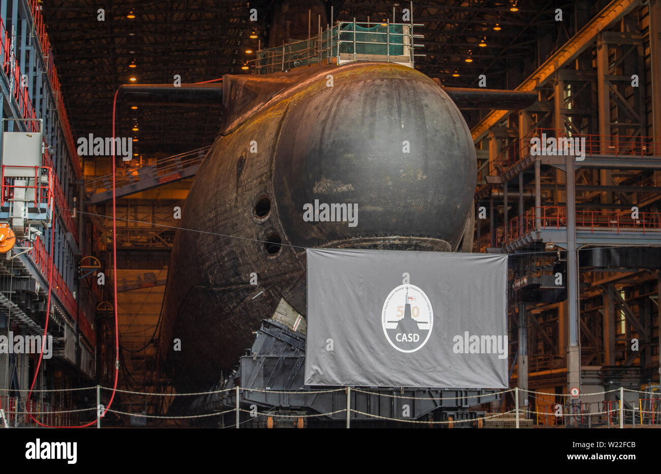 One of the Vanguard Class Ship nuclear submarines in dry dock at HM Naval Base Clyde, the home of the UK Submarine Service at Faslane in Argyll and Bute. - Stock Image