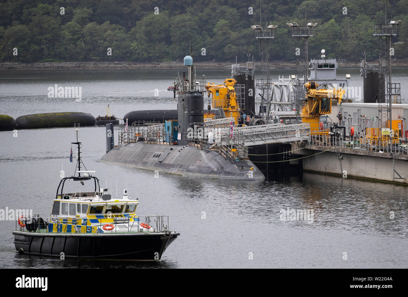 One of the Vanguard Class Ship nuclear submarines in the dock at HM Naval Base Clyde, the home of the UK Submarine Service at Faslane in Argyll and Bute. - Stock Image