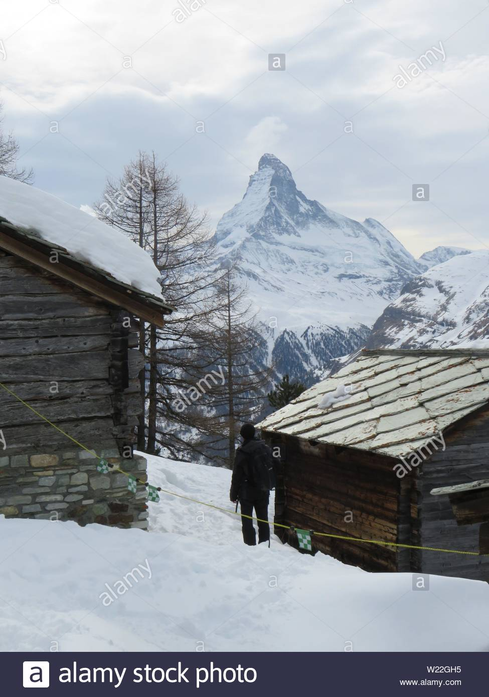 Two cabins in a snow covered mountain. - Stock Image