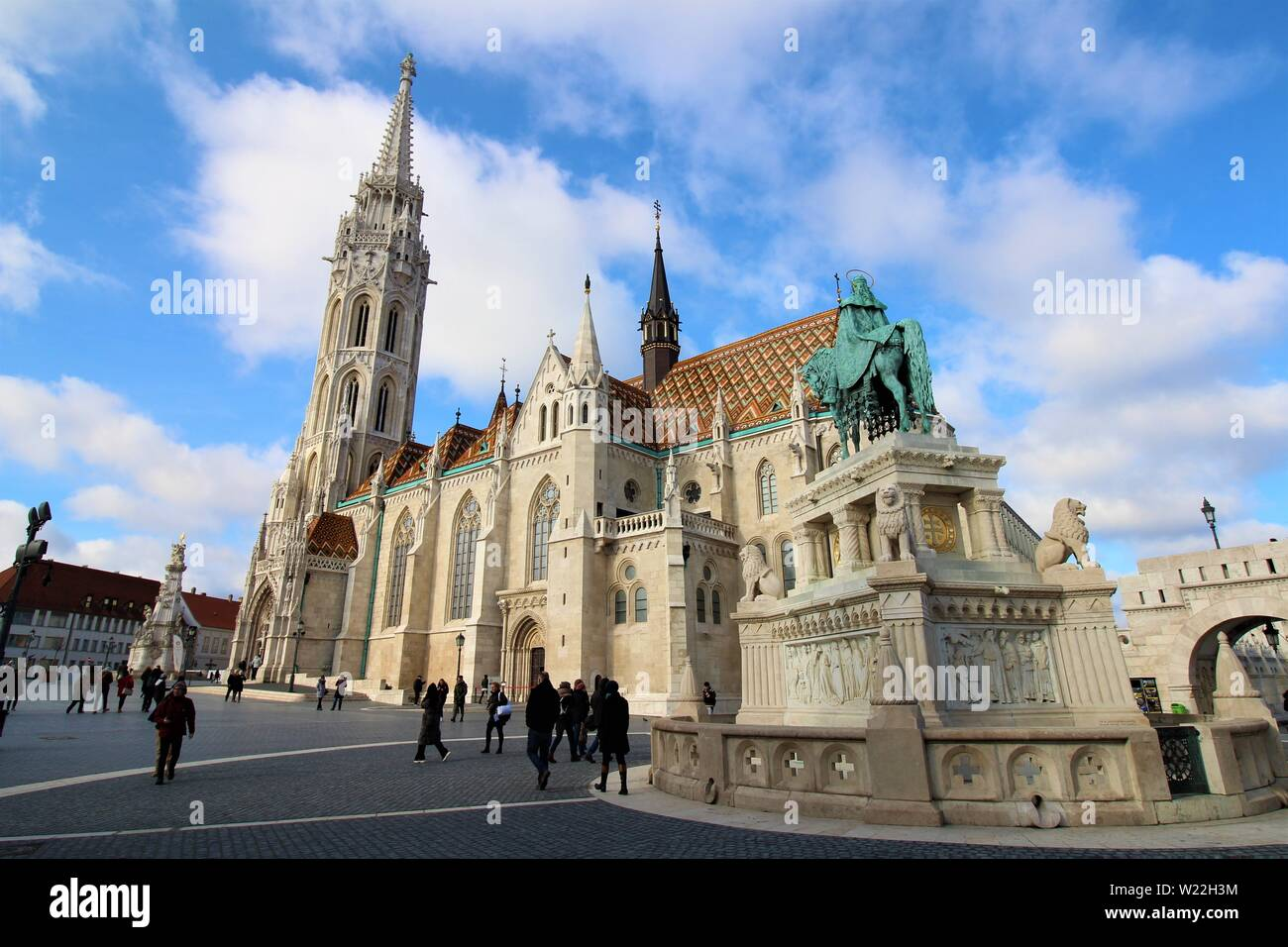 Tourists explore the southern courtyard of the Fisherman's Bastion alongside St Matthias Church, two of the top attractions of Budapest. Stock Photo