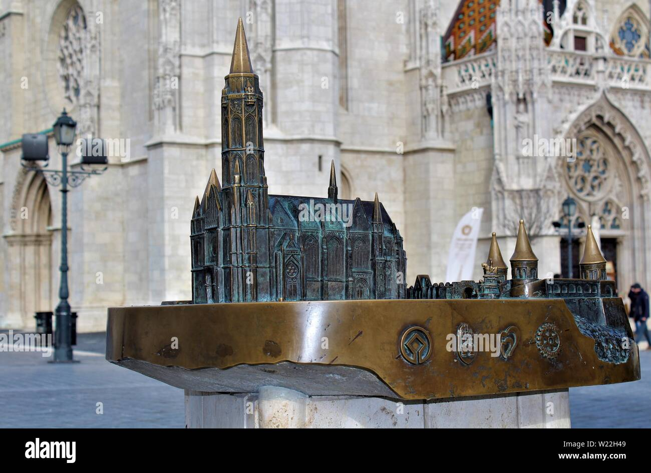 A bronze model of St Matthias church and Fishermans Bastion in Budapest, which is situated a short distance from the entrance to St Matthias church. Stock Photo