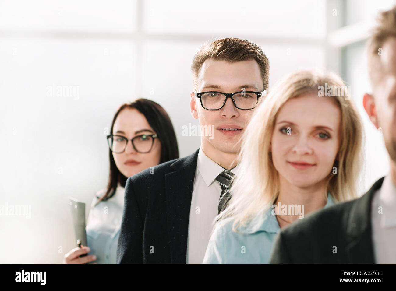 close up. professional staff of the company standing together. the concept of teamwork - Stock Image