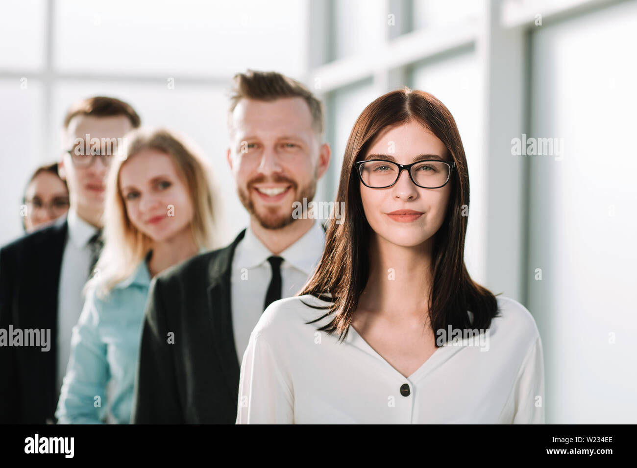 close up. confident business woman standing in front of his business team. the concept of teamwork - Stock Image
