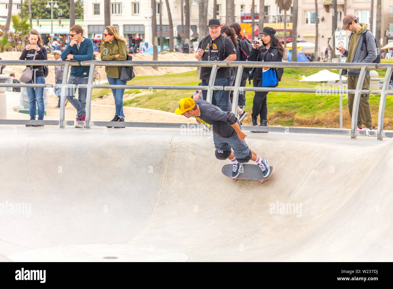LOS ANGELES, CALIFORNIA, USA - May 11, 2019: Concrete ramps and palm trees at the popular Venice beach skateboard park in Los Angeles, California Stock Photo
