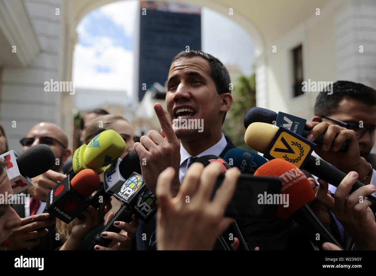 Caracas, Venezuela. 05th July, 2019. Juan Guaido, self-proclaimed interim president of Venezuela, talks to journalists when he comes to an Independence Day event in the National Assembly. Guaido has called on civil society to protest against the government of Head of State Maduro. Venezuela commemorates on July 5 the independence of Spain in 1811. Credit: Rafael Hernandez/dpa/Alamy Live News - Stock Image