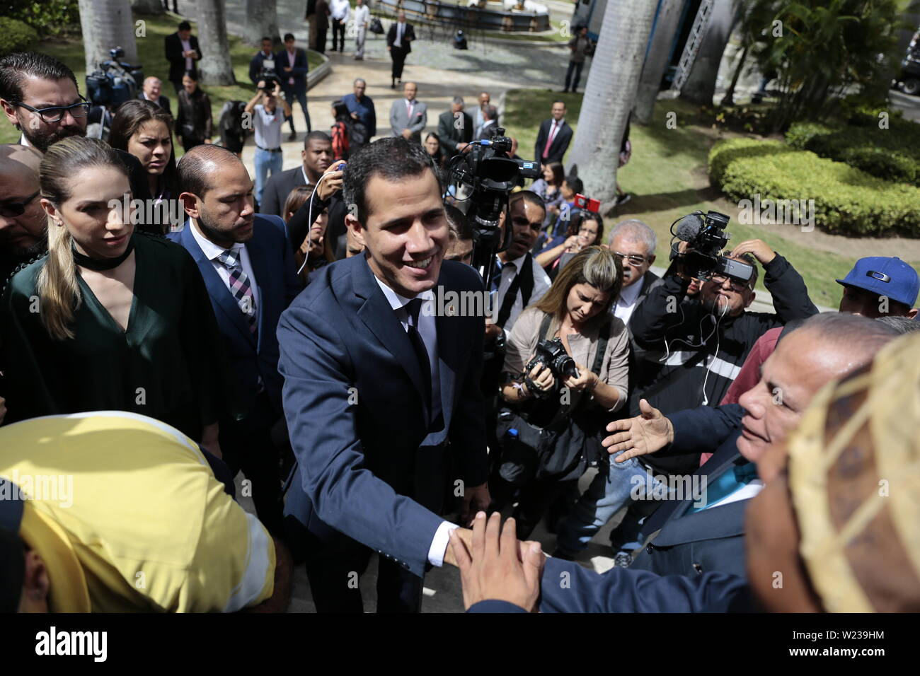Caracas, Venezuela. 05th July, 2019. Juan Guaido, self-proclaimed interim president of Venezuela, greets supporters as he joins his wife Fabiana Rosales (l) for an Independence Day event at the National Assembly. Guaido has called on civil society to protest against the government of Head of State Maduro. Venezuela commemorates on July 5 the independence of Spain in 1811. Credit: Rafael Hernandez/dpa/Alamy Live News - Stock Image
