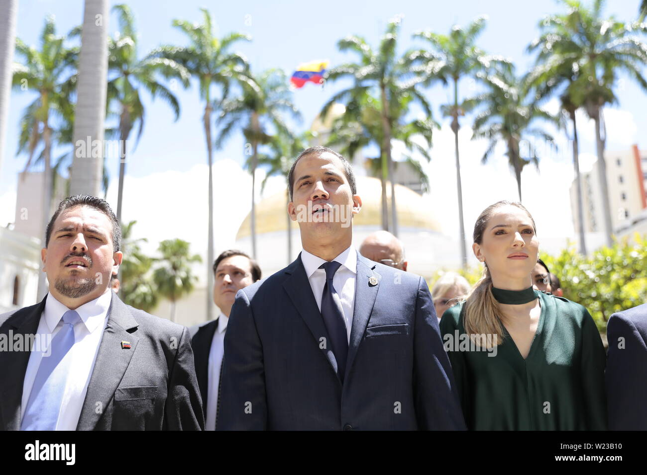 Caracas, Venezuela. 05th July, 2019. Juan Guaido (M.), self-proclaimed interim president of Venezuela, and his wife Fabiana Rosales (r) are taking part in an Independence Day event on the premises of the National Assembly. Guaido has called on civil society to protest against the government of Head of State Maduro. Venezuela commemorates on July 5 the independence of Spain in 1811. Credit: Rafael Hernandez/dpa/Alamy Live News - Stock Image
