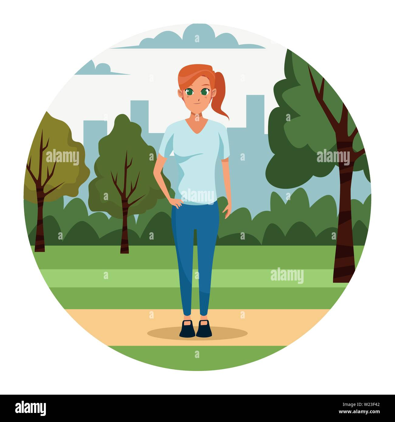 Young woman in the park - Stock Image