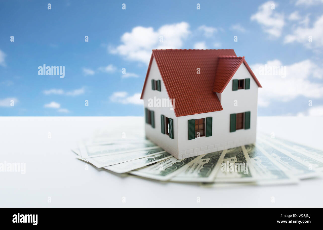 close up of home or house model and money - Stock Image