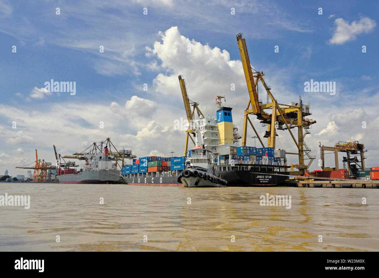 bangkok, thailand - august 28, 2008: containerships loading