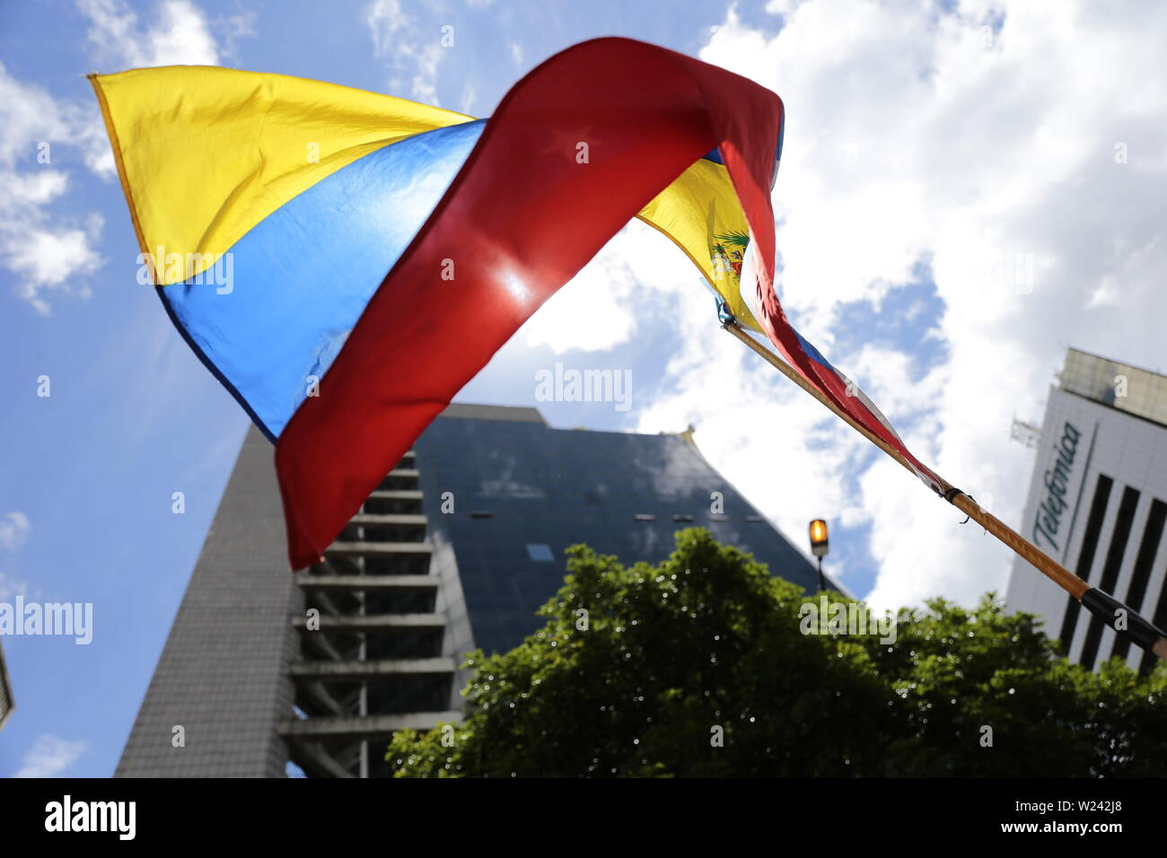 Caracas, Venezuela. 05th July, 2019. The Venezuelan flag is flying in front of the headquarters of the United Nations Development Programme (UNDP) in the Venezuelan capital. The opposition leader and self-appointed interim president Guaido had called on civil society to protest against the government of head of state Maduro. Venezuela commemorates on July 5 the independence of Spain in 1811. Credit: Rafael Hernandez/dpa/Alamy Live News - Stock Image