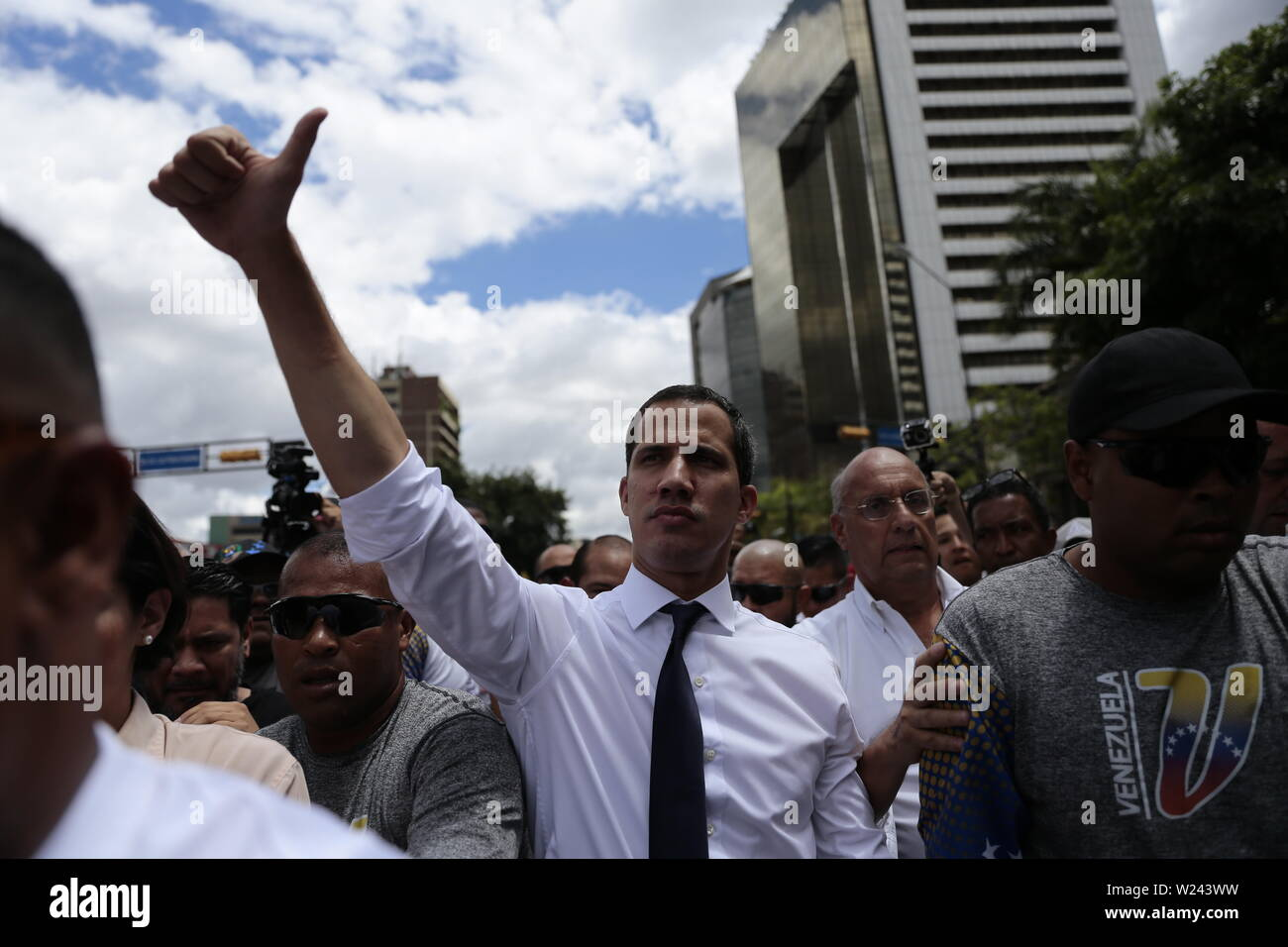 Caracas, Venezuela. 05th July, 2019. Juan Guaido, Venezuela's self-proclaimed interim president, is optimistic in front of supporters in a protest on Independence Day. Guaido has called on civil society to protest against the government of Head of State Maduro. Venezuela commemorates on July 5 the independence of Spain in 1811. Credit: Rafael Hernandez/dpa/Alamy Live News - Stock Image