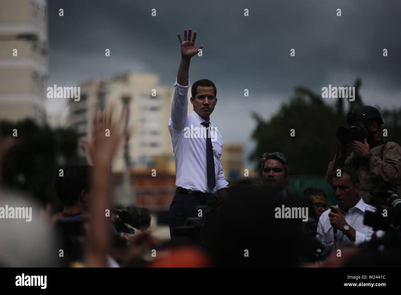 Caracas, Venezuela. 05th July, 2019. Juan Guaido, self-proclaimed interim president of Venezuela, waves to supporters at a protest on Independence Day. Guaido has called on civil society to protest against the government of Head of State Maduro. Venezuela commemorates on July 5 the independence of Spain in 1811. Credit: Rafael Hernandez/dpa/Alamy Live News - Stock Image