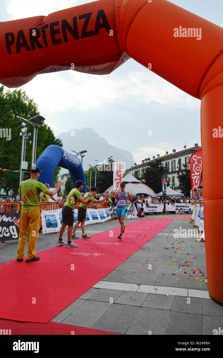 "Lecco/Italy - June 1, 2013: Sportswoman arrived at the finish of the ""Lecco city - Resegone mountain"" running marathon event. Stock Photo"