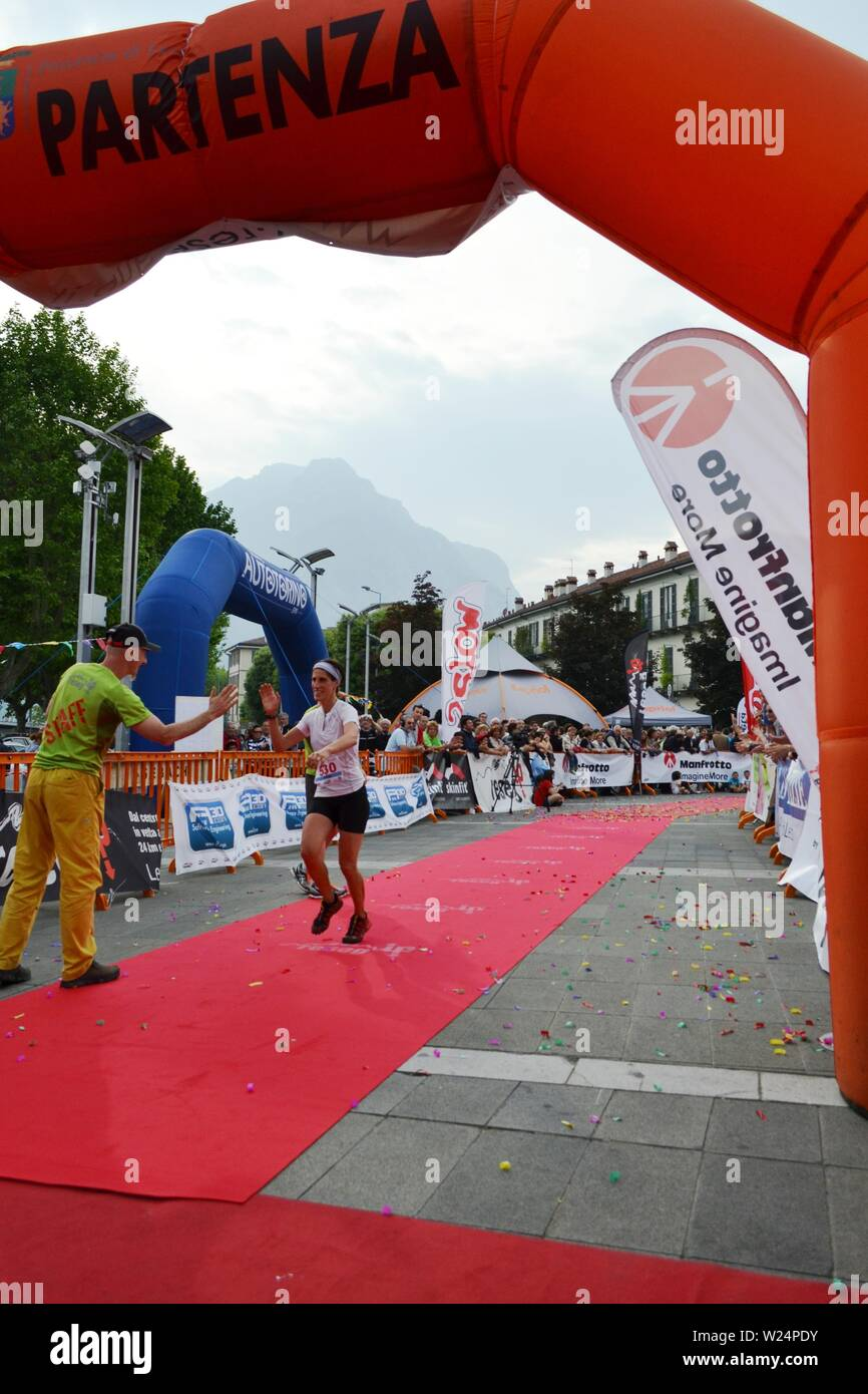 """Lecco/Italy - June 1, 2013: Sportswoman arrived at the finish of the """"Lecco city - Resegone mountain"""" running marathon event. Stock Photo"""