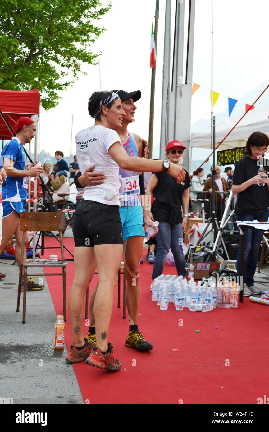 """Lecco/Italy - June 1, 2013: Sportswomen arrived at the finish of the """"Lecco city - Resegone mountain"""" running marathon event. Stock Photo"""