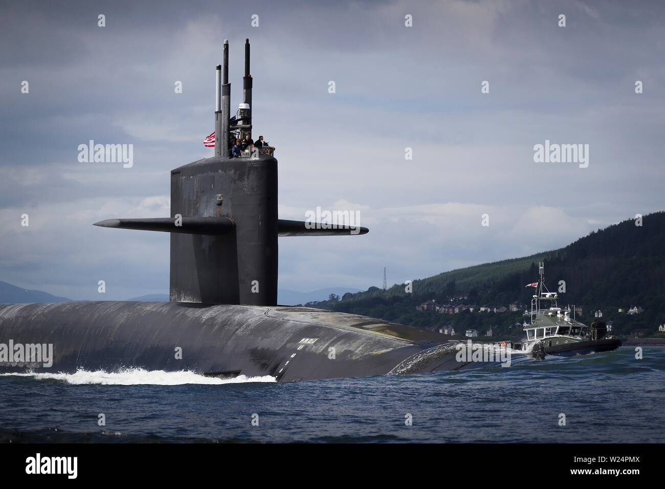 The U.S. Navy Ohio-class ballistic-missile nuclear submarine USS Alaska arrives for a port visit to Royal Navy Base Clyde July 2, 2019 in Faslane, Scotland. - Stock Image