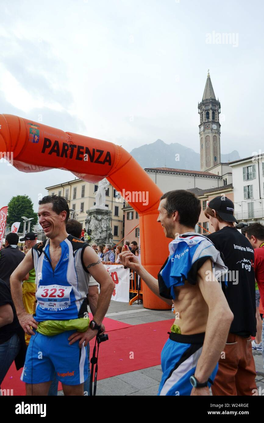 "Lecco/Italy - June 1, 2013: Sportsmen arrived at the finish of the ""Lecco city - Resegone mountain"" running marathon event. Stock Photo"