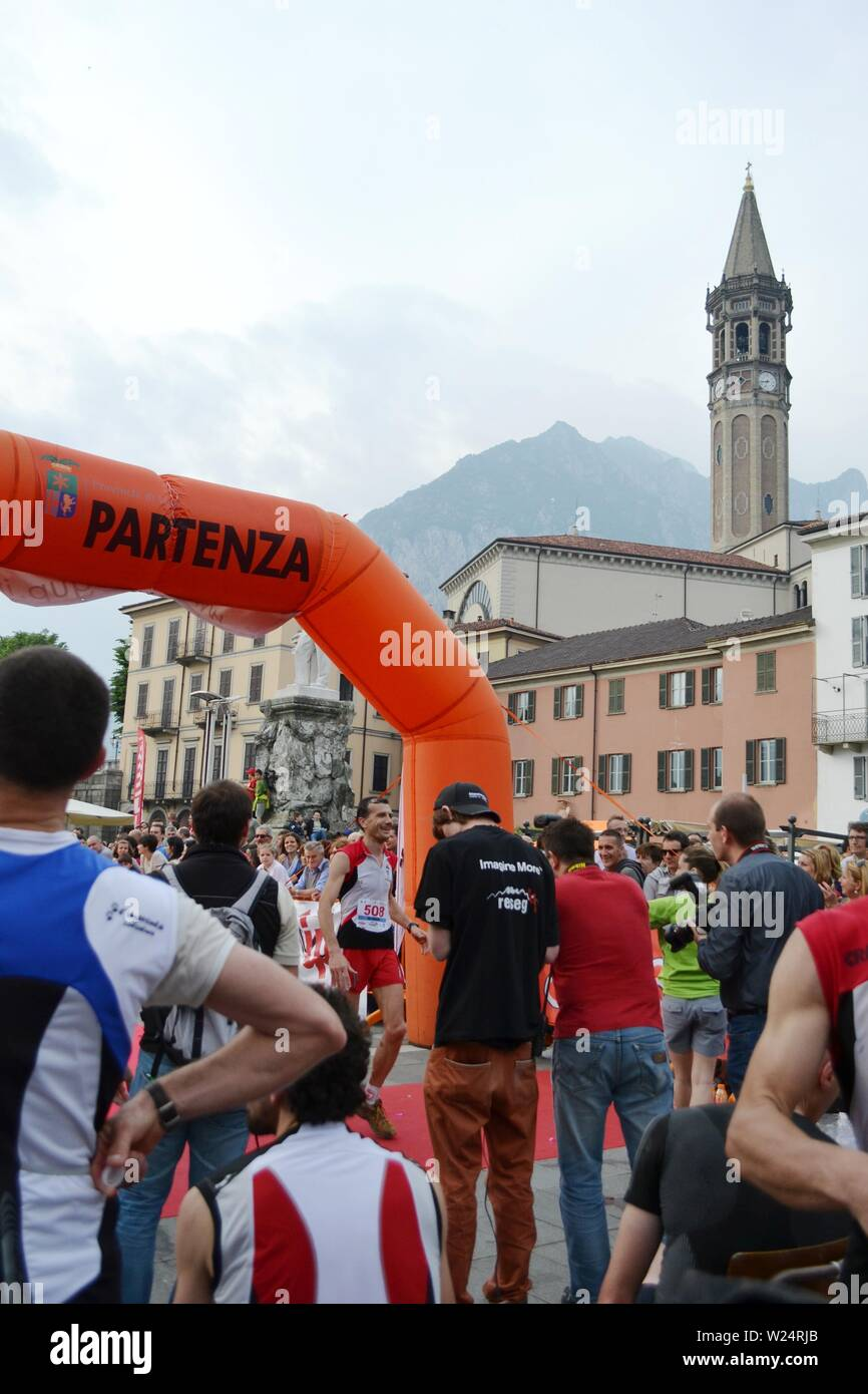 """Lecco/Italy - June 1, 2013: Sportsman arrived at the finish of the """"Lecco city - Resegone mountain"""" running marathon event. Stock Photo"""