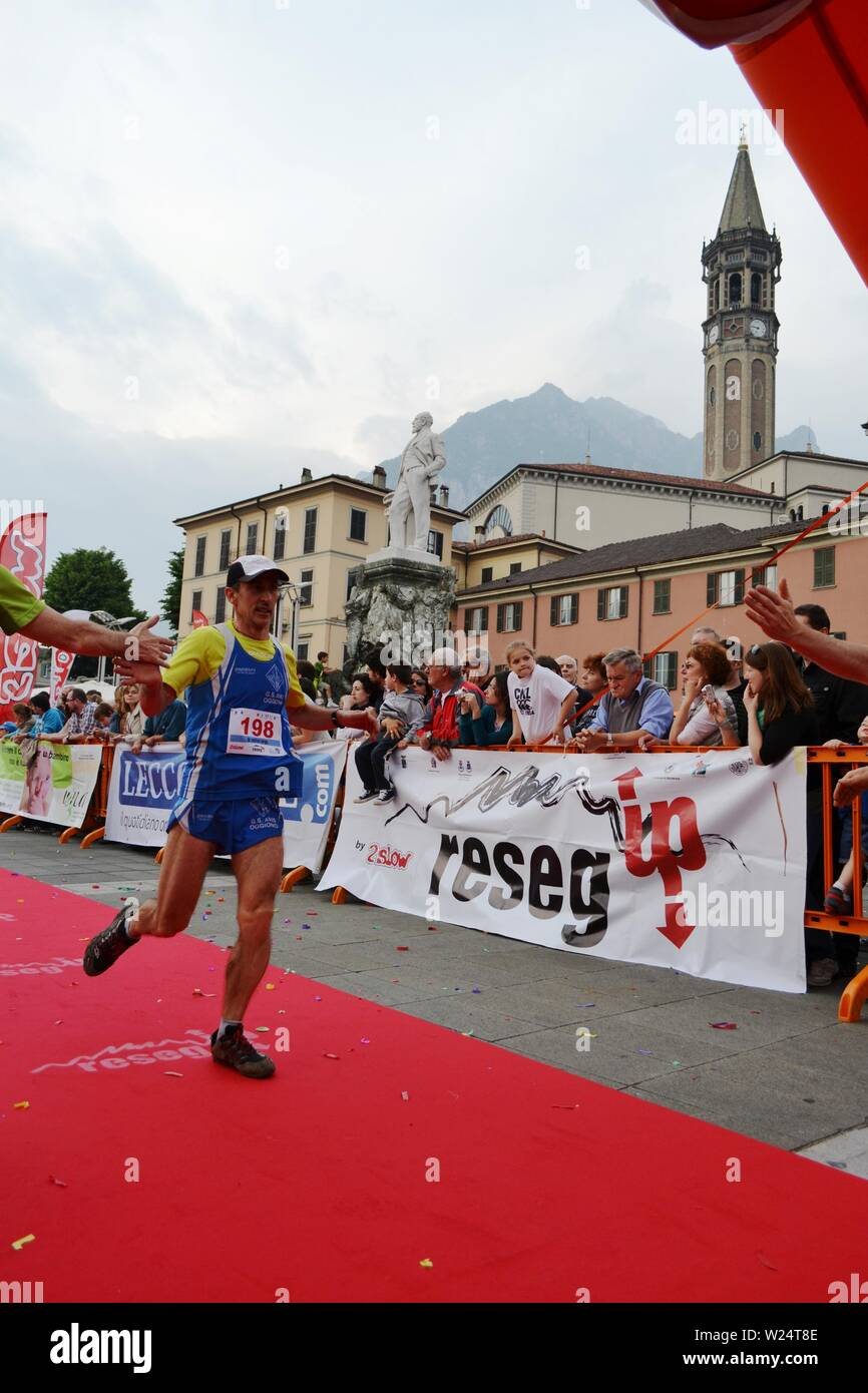 "Lecco/Italy - June 1, 2013: Sportsman arrived at the finish of the ""Lecco city - Resegone mountain"" running marathon event. Stock Photo"