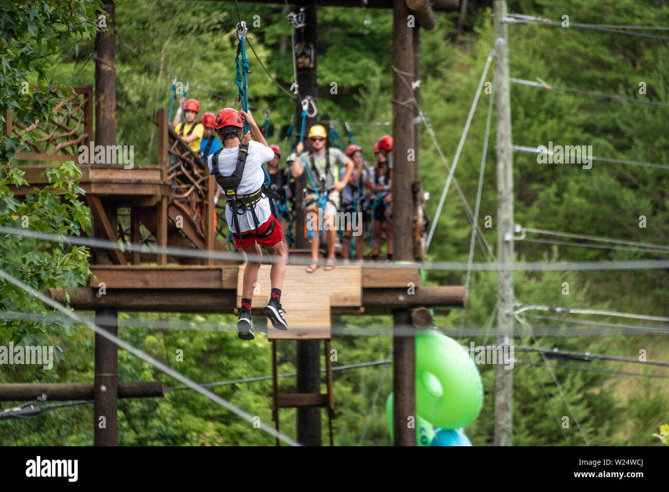 Teen ziplining at Cool River Adventures on the Chattahoochee