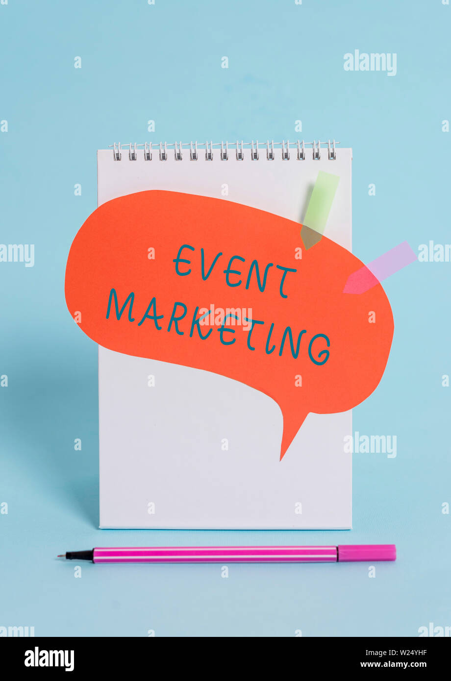 Conceptual hand writing showing Event Marketing. Concept meaning describes process of developing display to promote product Spiral notepad speech bubb Stock Photo