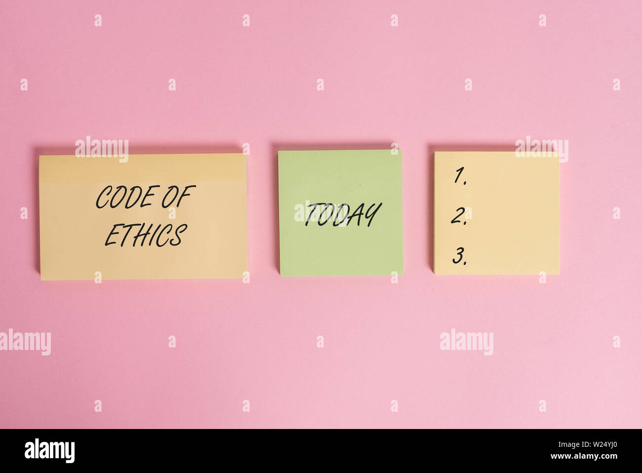 Writing note showing Code Of Ethics. Business concept for basic guide for professional conduct and imposes duties Close up front view three multicolor - Stock Image