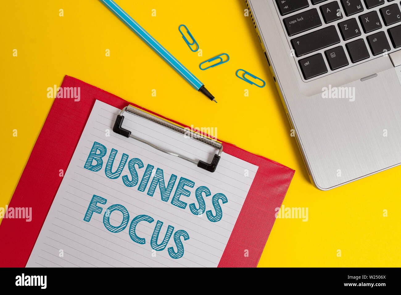 Word writing text Business Focus. Business photo showcasing Serving the needs of the client Full attention on details Open laptop clipboard blank pape - Stock Image