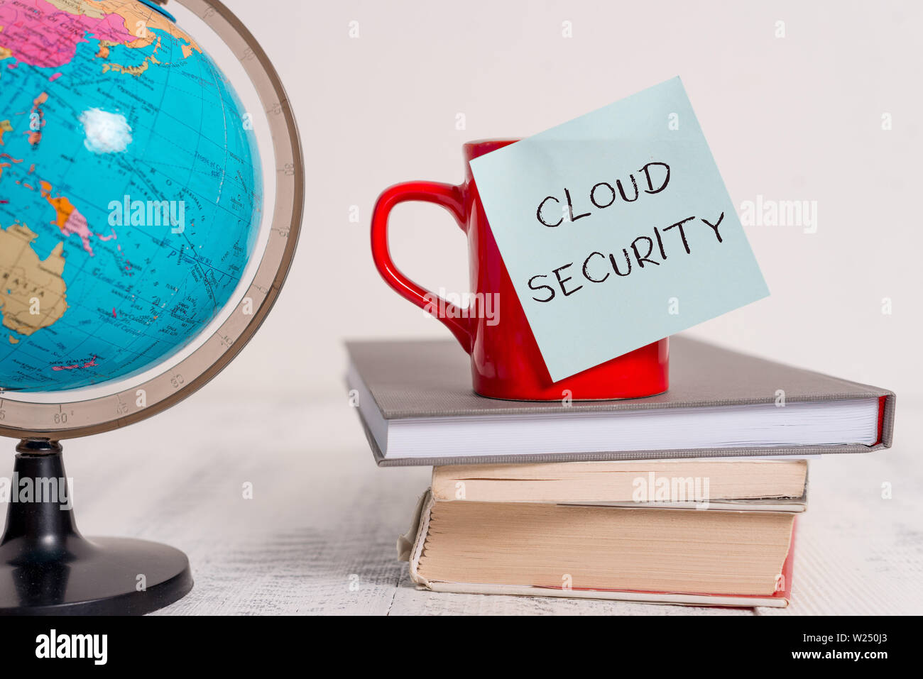 Writing note showing Cloud Security. Business concept for Protect the stored information safe Controlled technology Globe map world earth cup blank st - Stock Image