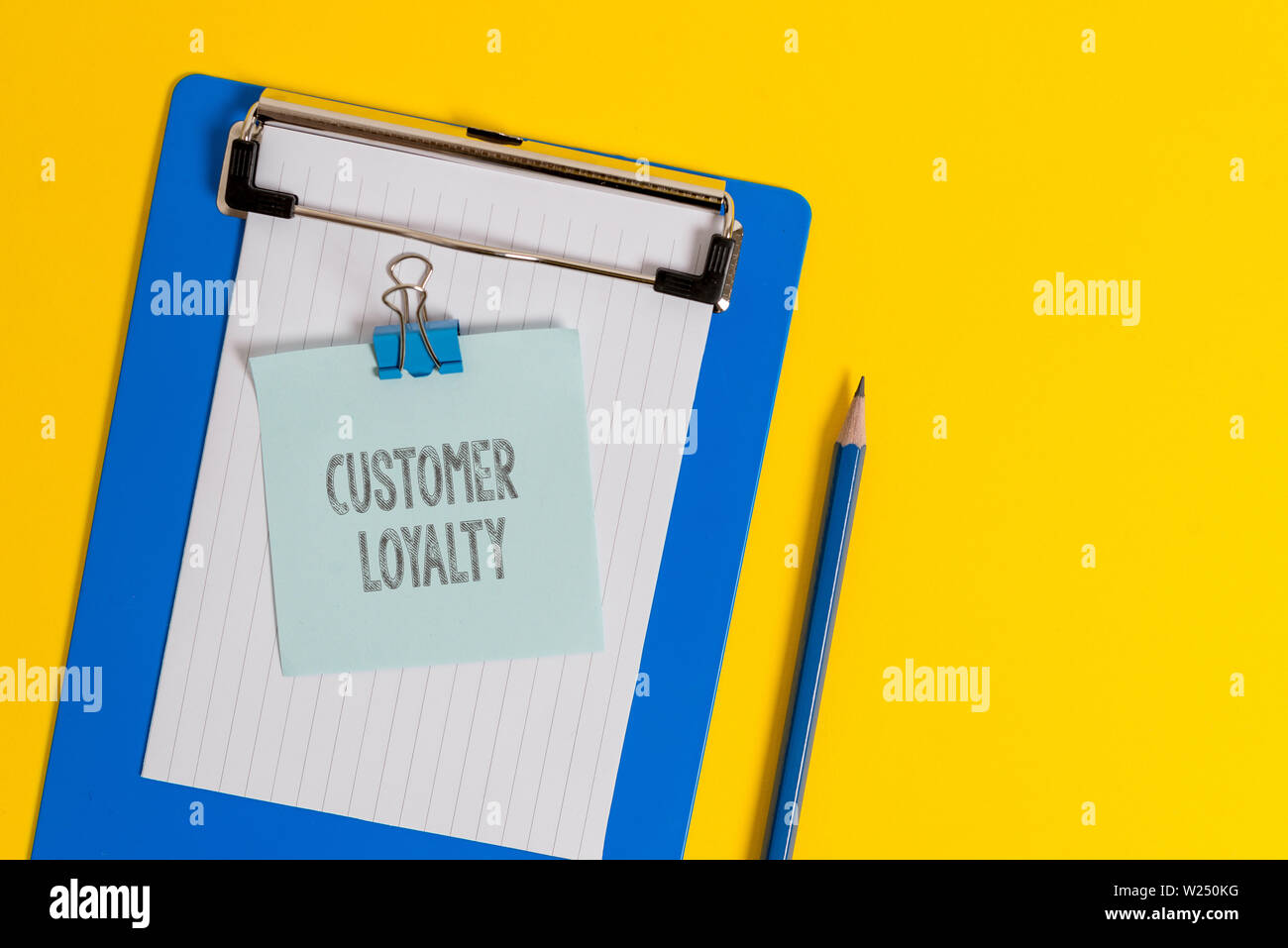 Handwriting text writing Customer Loyalty. Conceptual photo result of consistently positive emotional experience Clipboard holding blank paper sheet n - Stock Image