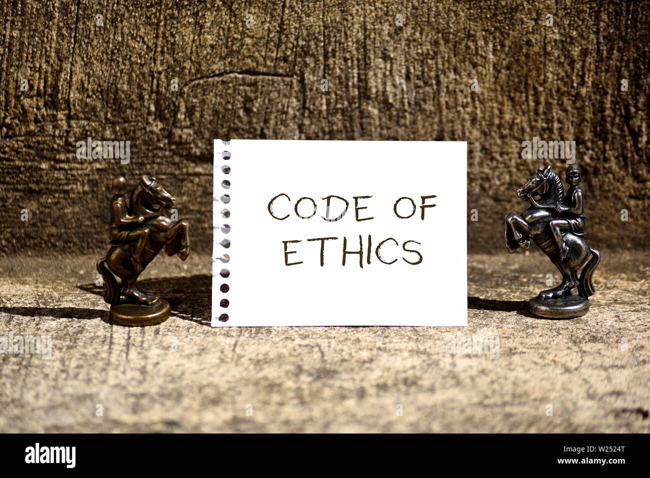 Conceptual hand writing showing Code Of Ethics. Concept meaning basic guide for professional conduct and imposes duties Two Bronze Chessmen Knights Ri - Stock Image