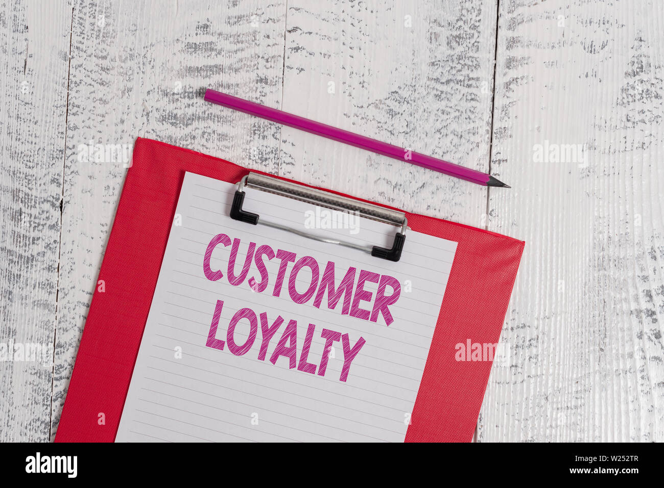 Handwriting text Customer Loyalty. Conceptual photo result of consistently positive emotional experience Colored clipboard blank paper sheet pencil ol - Stock Image