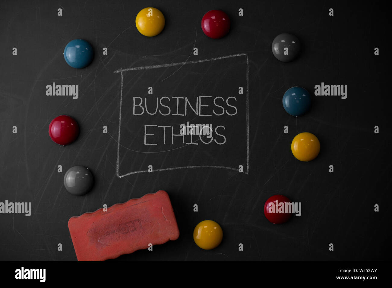 Text sign showing Business Ethics. Business photo text Moral principles that guide the way a business behaves Round Flat shape stones with one eraser - Stock Image