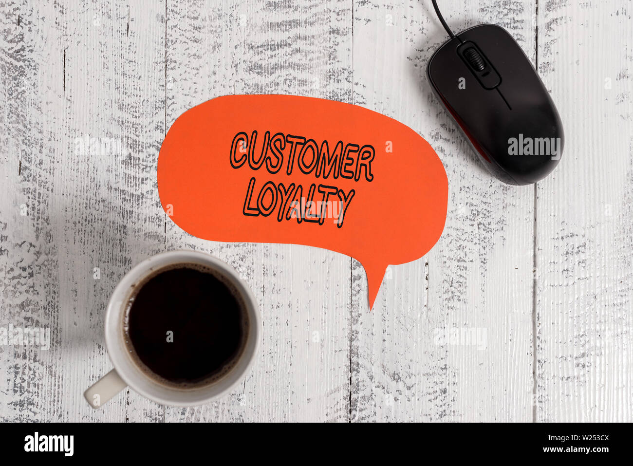 Conceptual hand writing showing Customer Loyalty. Concept meaning result of consistently positive emotional experience Wooden vintage table background - Stock Image