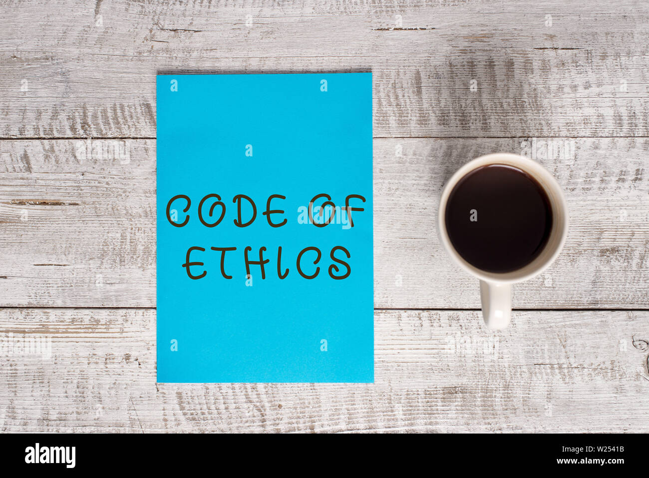 Conceptual hand writing showing Code Of Ethics. Concept meaning basic guide for professional conduct and imposes duties Stationary placed next to a co - Stock Image