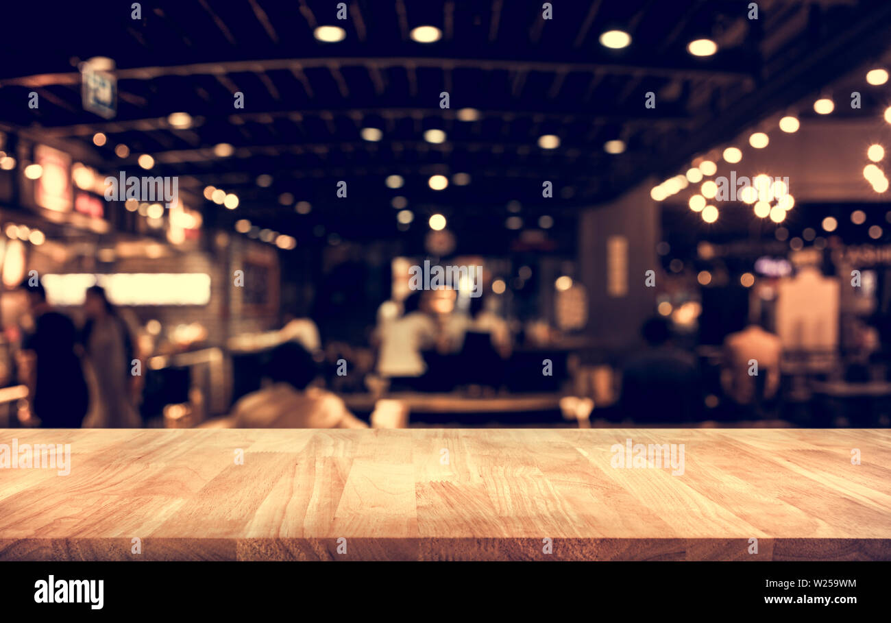 Wood Table Top Bar With Blur Light Bokeh In Dark Night Cafe Restaurant Background Lifestyle And Celebration Concepts Ideas Stock Photo Alamy