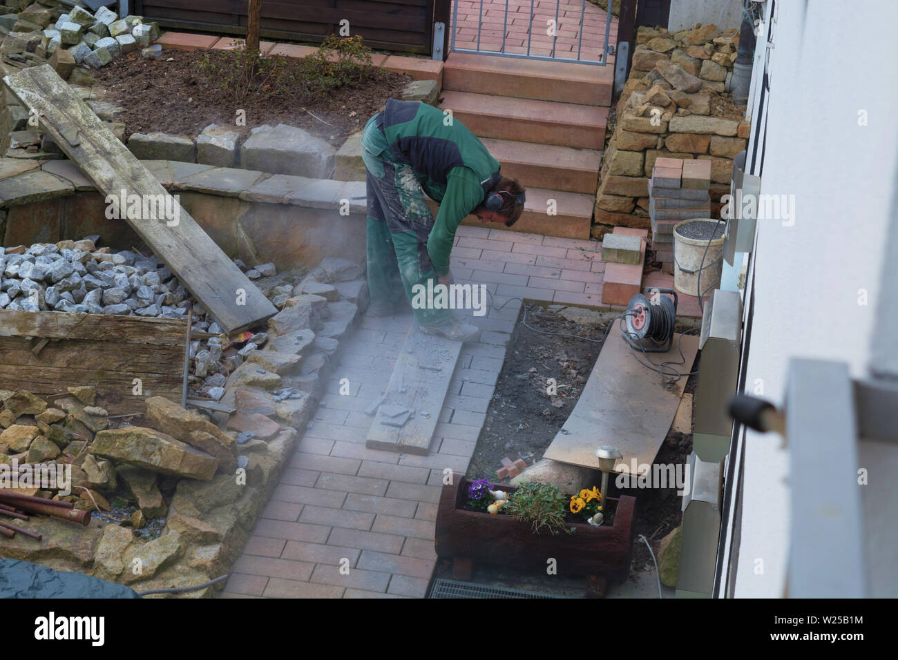 Reworking with technology Tile cutting with an angle grinder - Stock Image