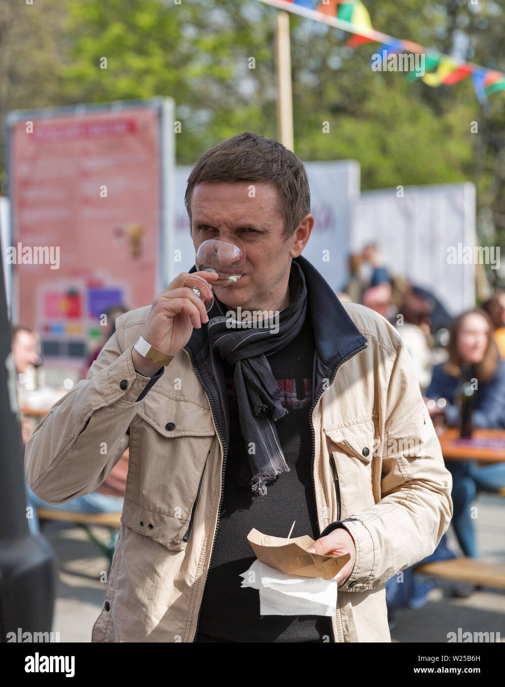 KYIV, UKRAINE - APRIL 21, 2019: People tasting wine during Food and Wine Festival in National Expocenter, a permanent multi-purpose exhibition complex Stock Photo