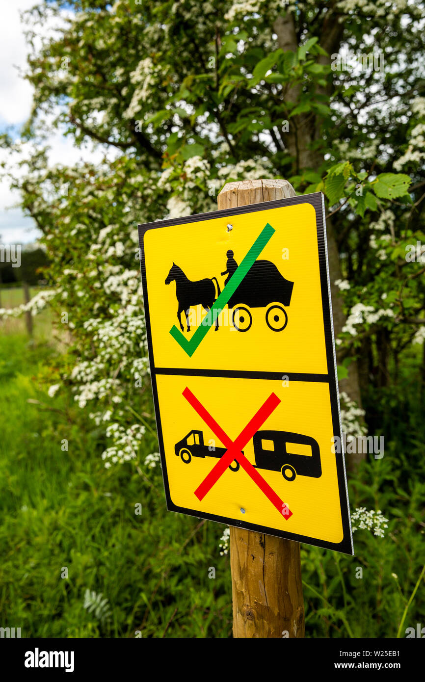 UK, Cumbria, Sedbergh, Hebblethwaites, Appleby Horse Fair preparation, sign preventing gypsy caravans or traveller's horse drawn vehicles from overnig Stock Photo