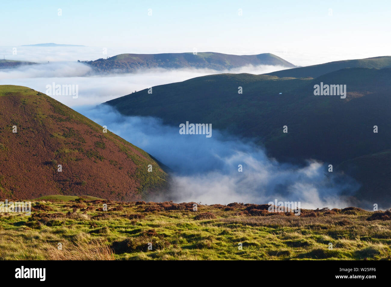 View of the Shropshire Hills from the Long Mynd, with clouds in the valley. Above the clouds, looking down. UK Stock Photo