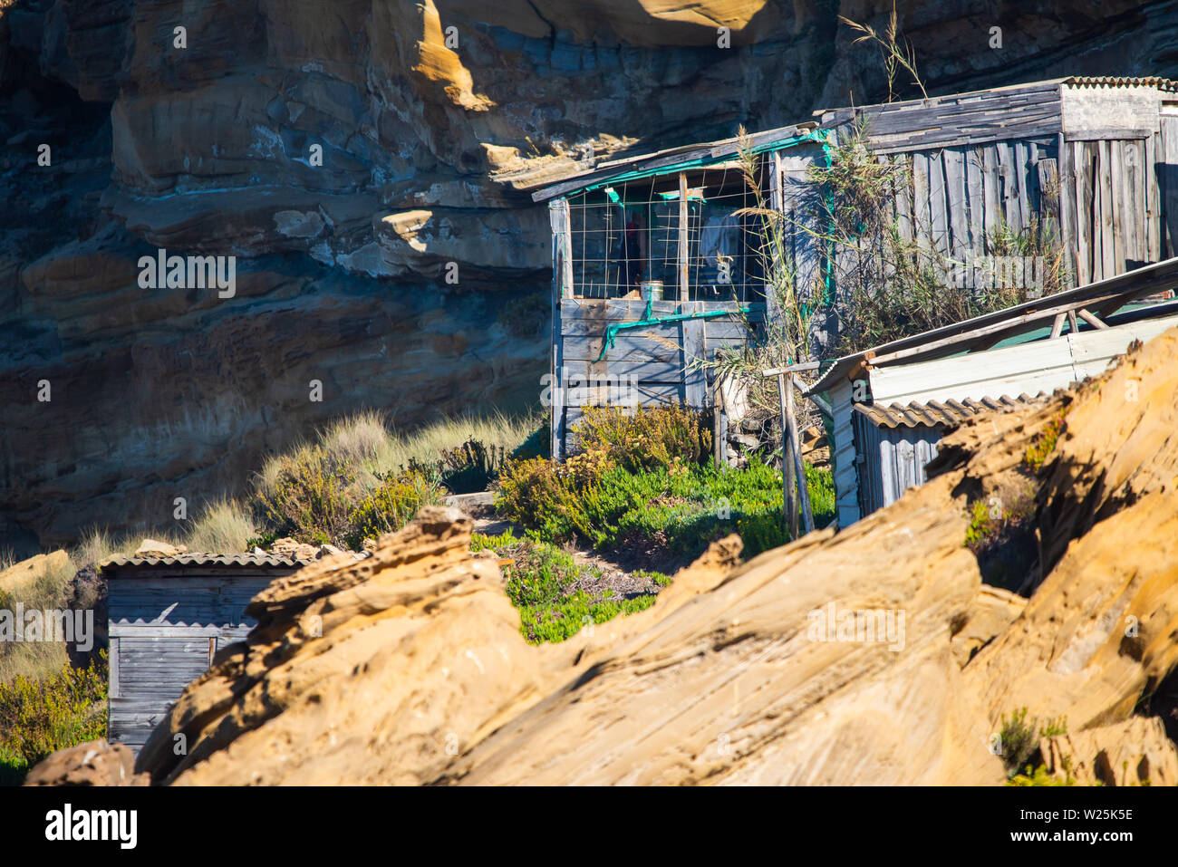 Old abandoned wooden house stands in the summer in the mountains. - Stock Image