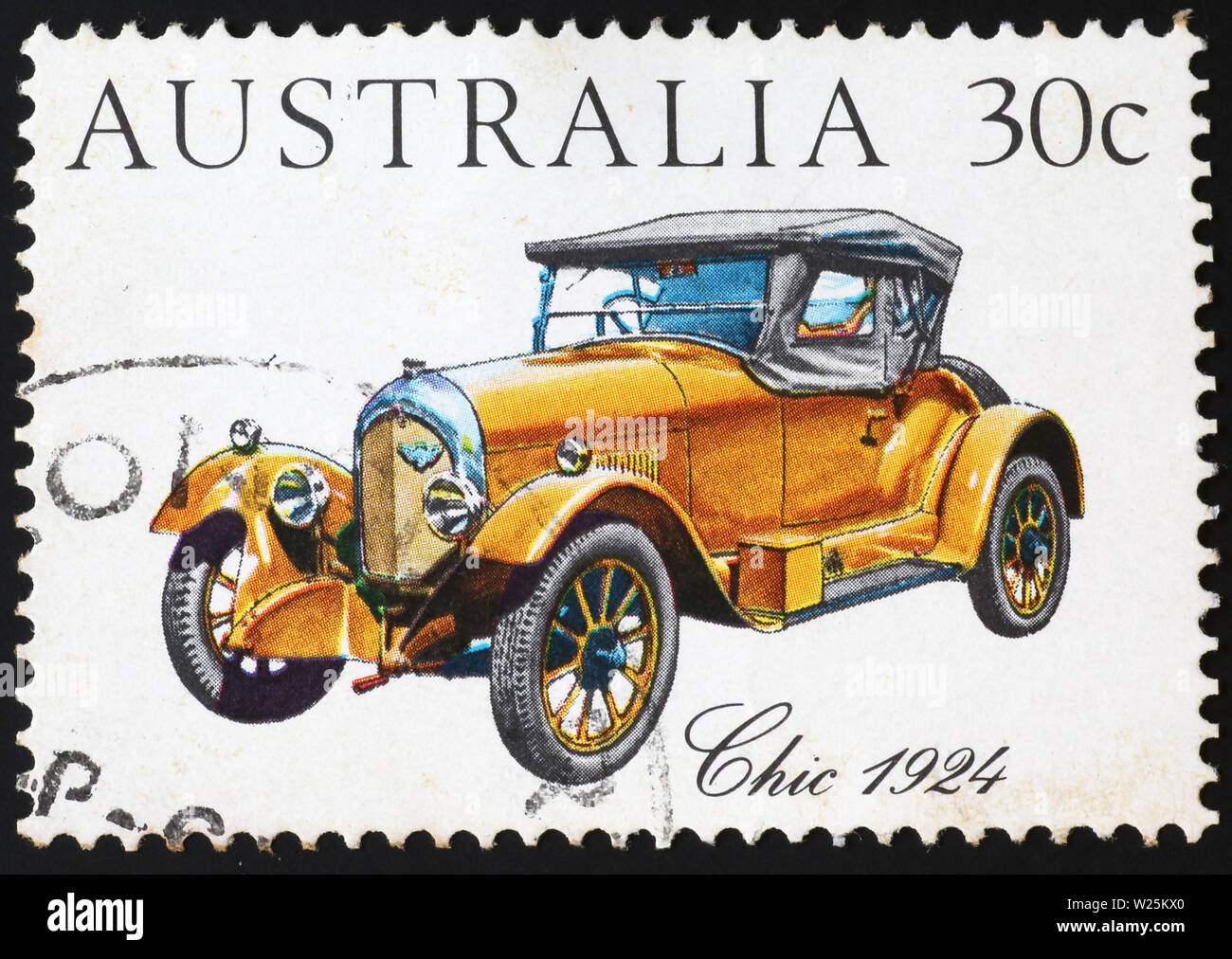 Beautiful antique yellow car on australian postage stamp - Stock Image