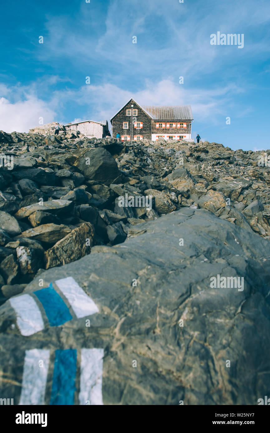 Mountain hut in rocky alpine landscape in Austria - Stock Image