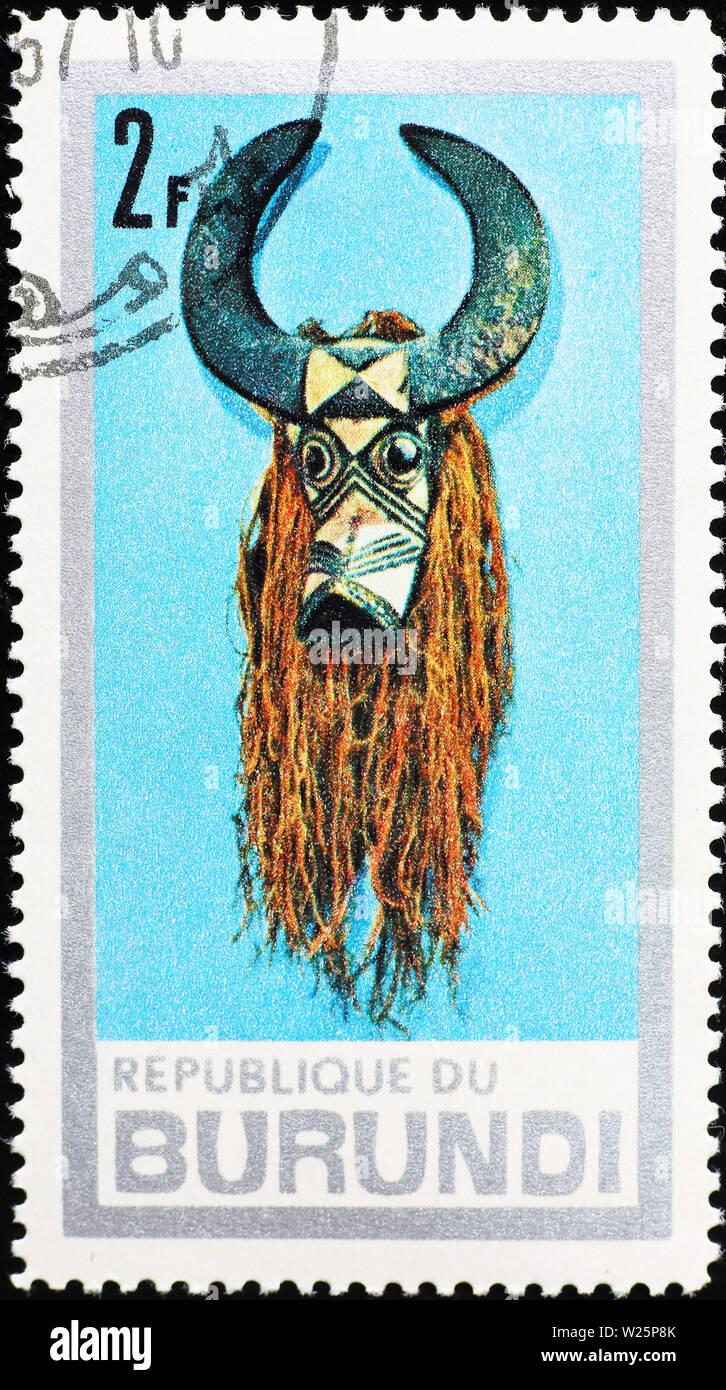 Tribal mask on postage stamp of Burundi - Stock Image
