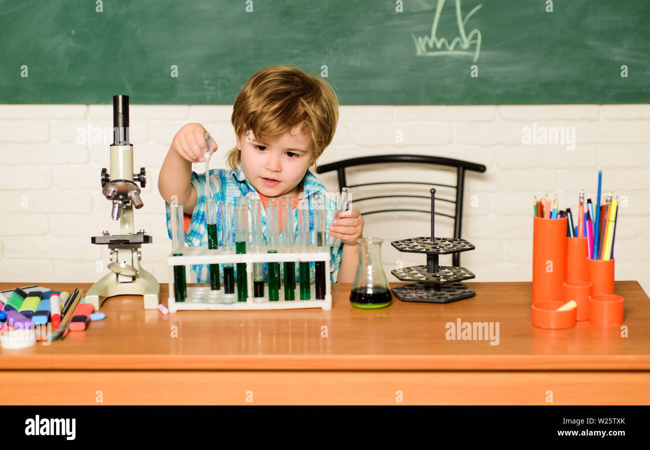 Discover liquids. Practical knowledge concept. Study grants and scholarship. Boy performing chemistry test. Wunderkind and early development. Small pupil learn chemistry school. Chemistry laboratory. - Stock Image