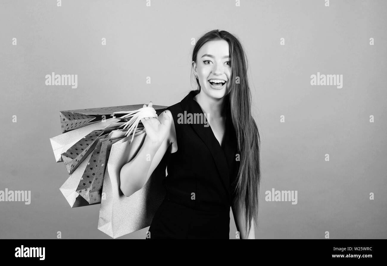 Shopping is her passion. Mid season sale. Girl hold bunch packages. Discount and special offer. Black friday shopping. Obsessed with purchase. Beautiful woman with shopping bags smile happy face. - Stock Image
