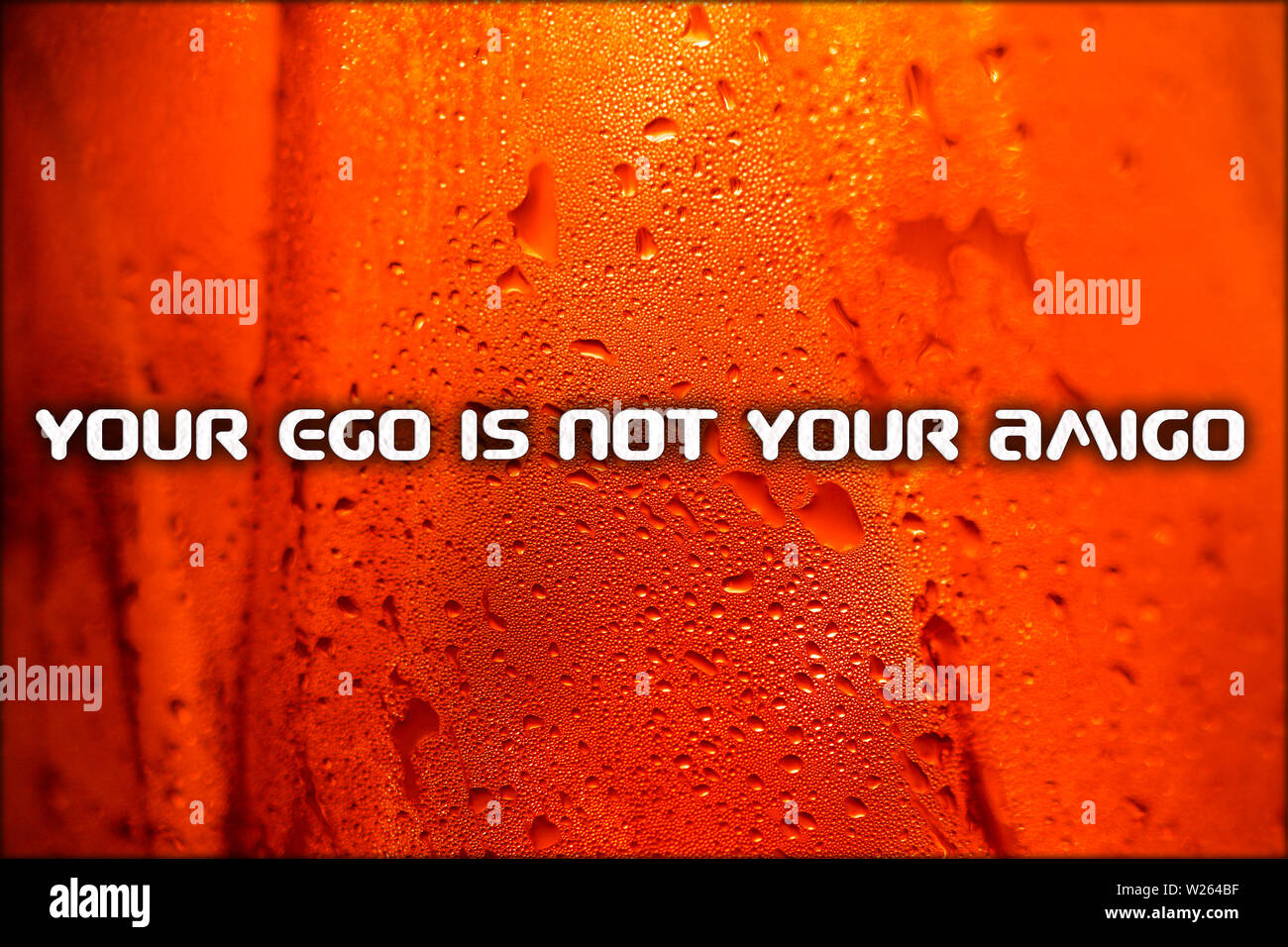 Text your ego is not you amigo quote in red liquid drops macro background - Stock Image