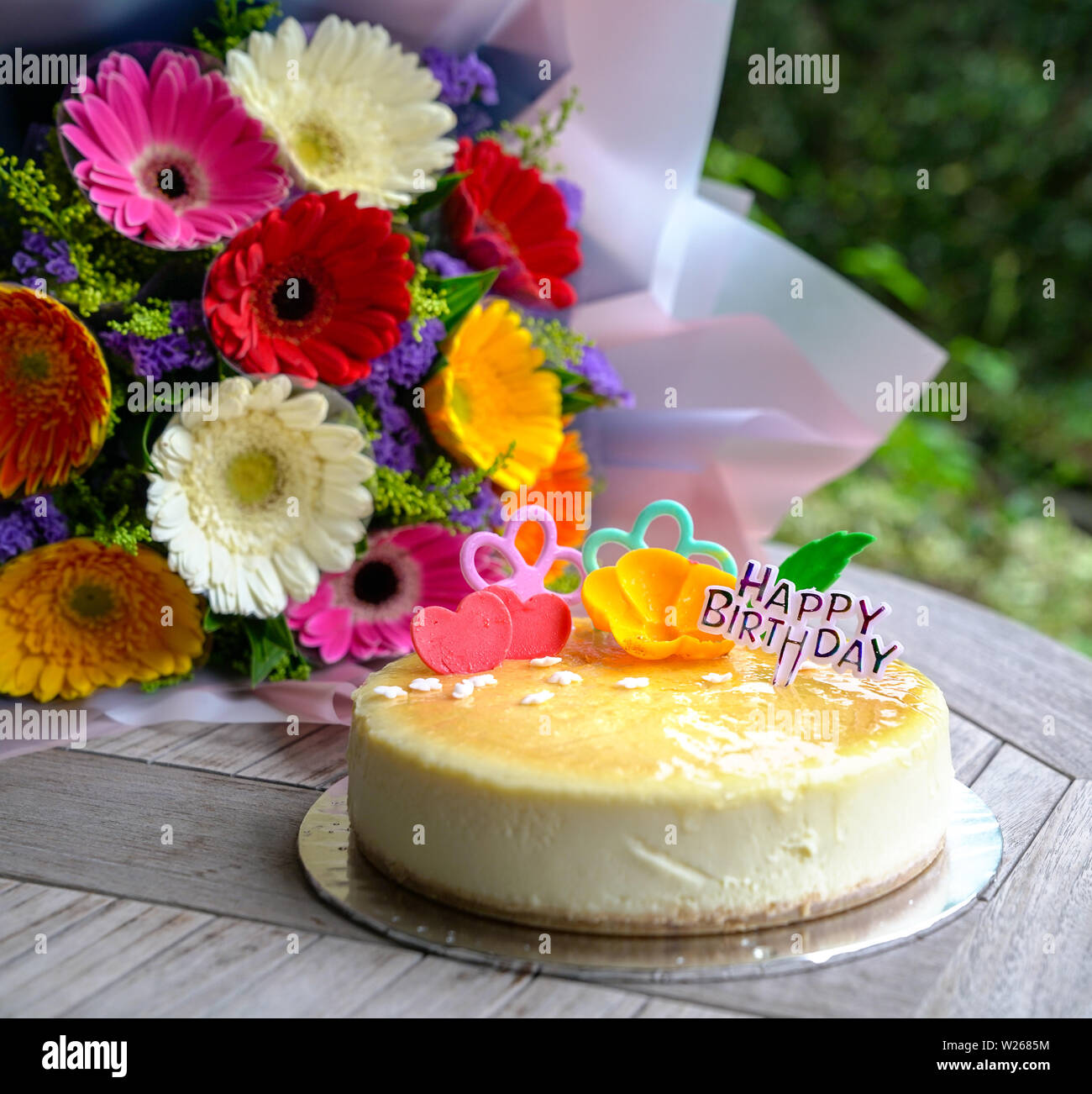 Bouquet Of Gerbera Daisy Flowers And Cheese Cake As Birthday Present Or Gift Stock Photo Alamy